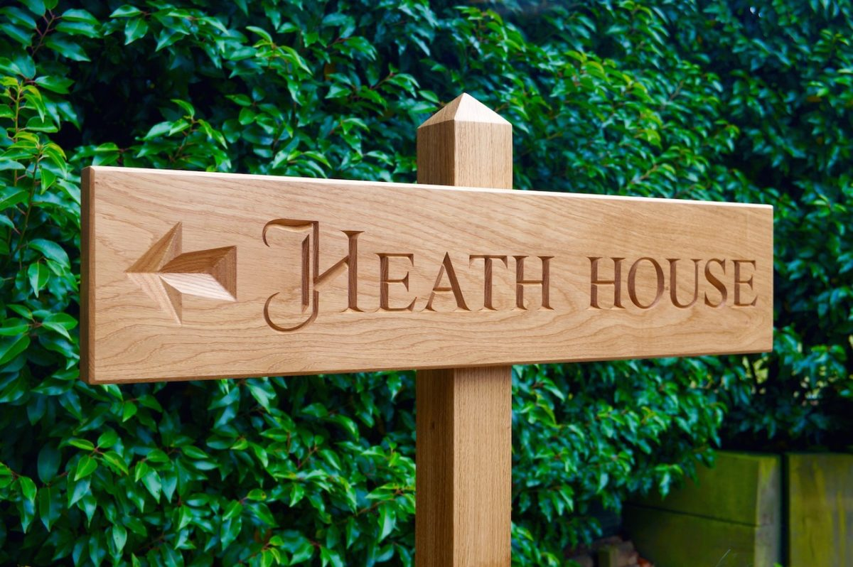 engraved wooden house sign